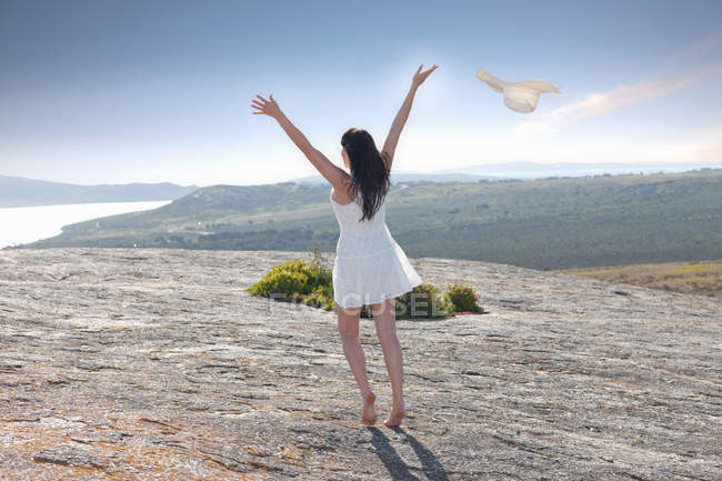 Woman playing on rock formation — Stock Photo