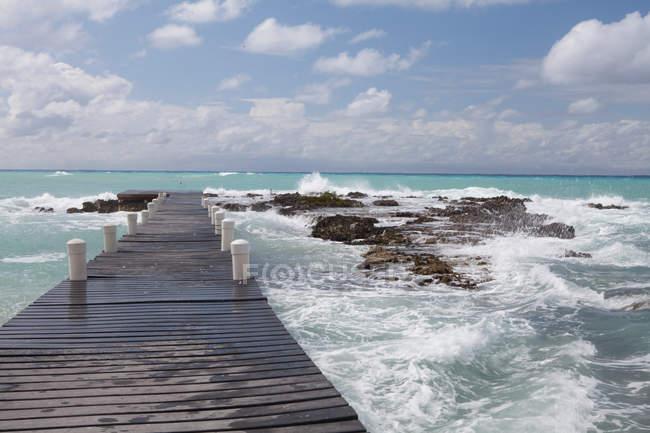 Jetty into Caribbean Sea, Grand Cayman, Cayman Islands — Stock Photo