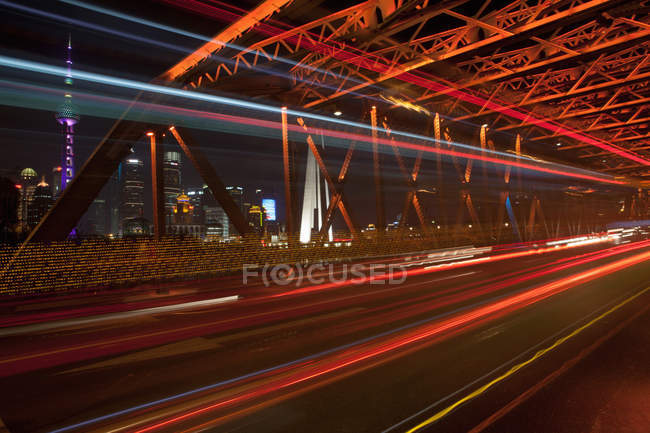 Cars travelling across bridge at night, long exposure, Shanghai, China — Stock Photo