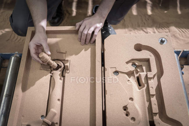 Worker preparing sand mould in precision casting factory, close up — Stock Photo