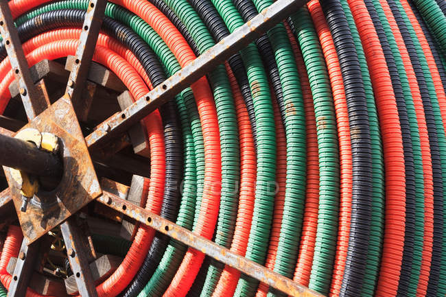 Colorful coiled hose — Stock Photo