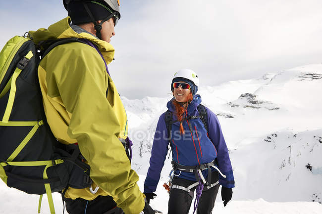 Mountaineers on snow-covered mountain smiling, Saas Fee, Switzerland — Stock Photo