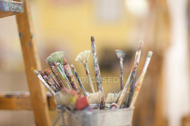 Different Paintbrushes in pot — Stock Photo