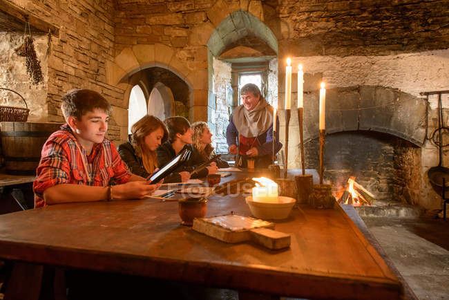 History students in Bolton Castle, a 14th century Grade 1 listed building and Scheduled Ancient Monument. — Stock Photo