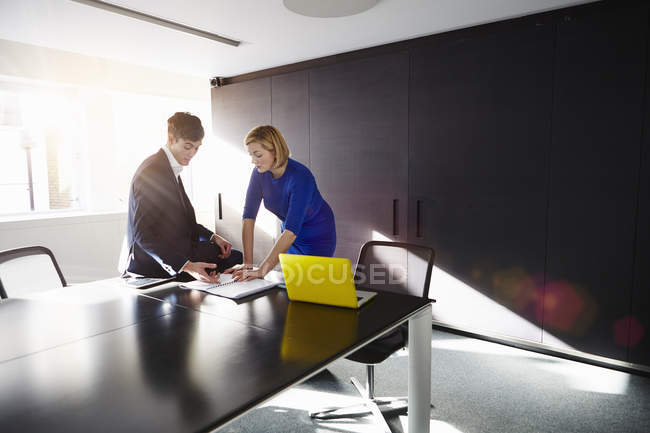 Colleagues in conference room discussing paperwork — Stock Photo