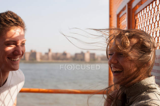 Young couple on a ferry, wind blowing hair — Stock Photo