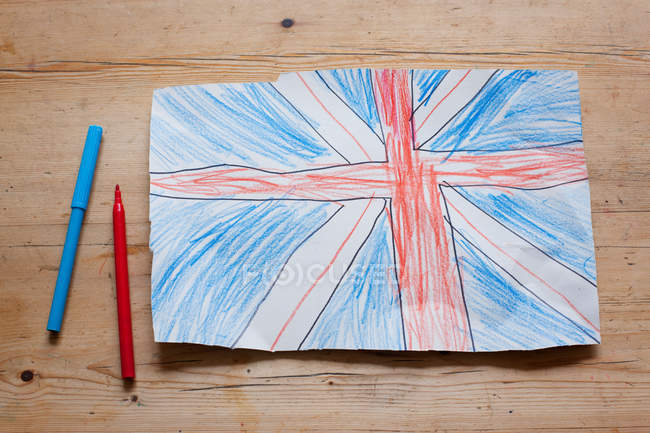 Drawing of British Union Flag with felt pens on wooden table — Stock Photo
