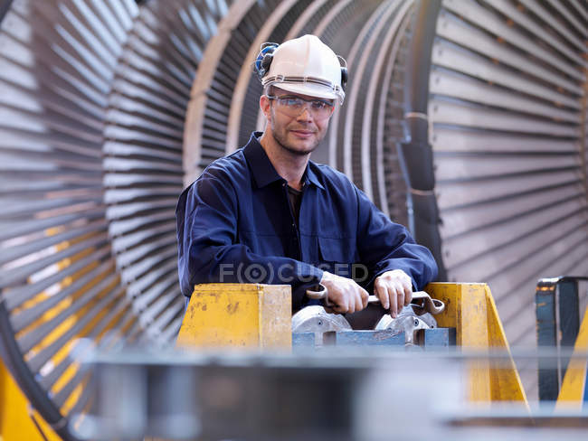 Engineer In Front Of Turbine — Stock Photo