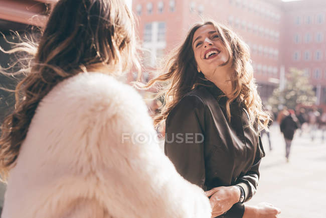 Twin sisters, outdoors, fooling around, laughing — Stock Photo