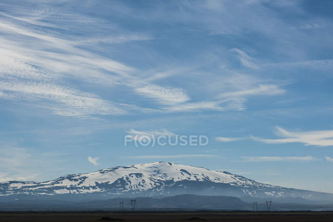 Snowcapped Volcano Hekla under blue cloudy sky — Stock Photo