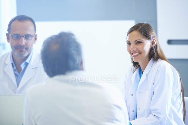 Group of male and female researchers having meeting — Stock Photo
