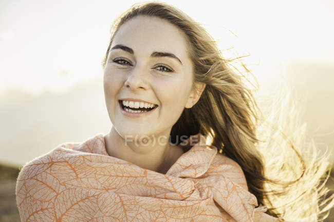 Woman enjoying breeze on sunny day — Stock Photo