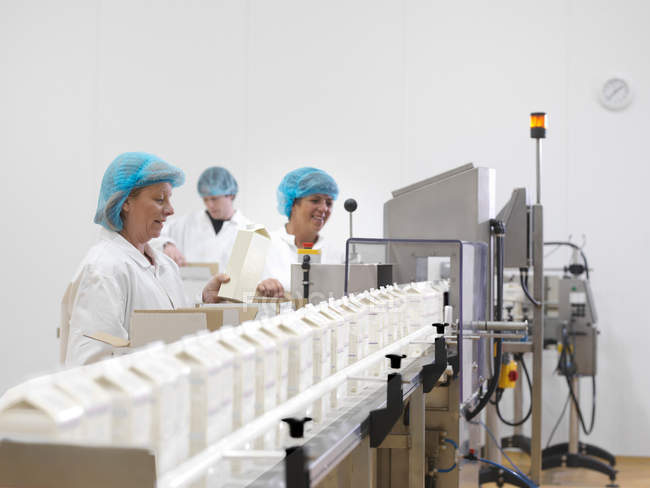 Food Workers On Production Line — Stock Photo