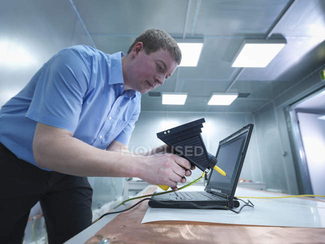 Engineer carrying out electro static discharge, selective focus — Stock Photo