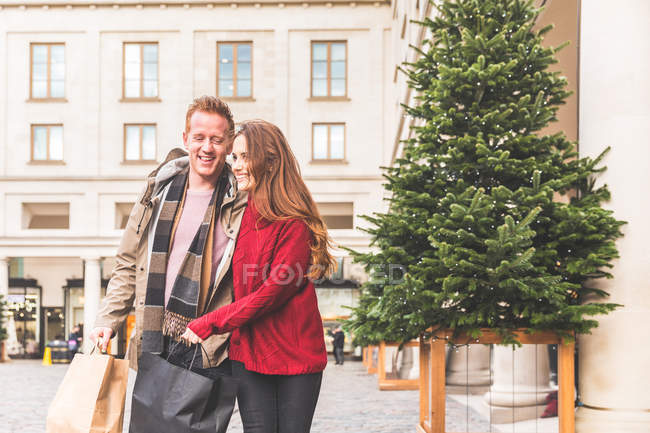 Couple walking and hugging, Covent Garden, London, UK — Stock Photo