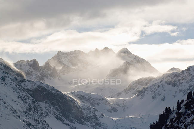 Clouds and mountain peaks in tyrol — Stock Photo