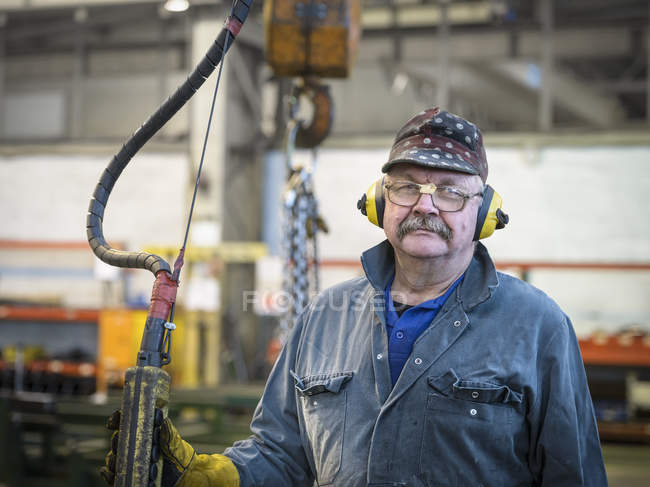 Portrait of crane operator in factory — Stock Photo