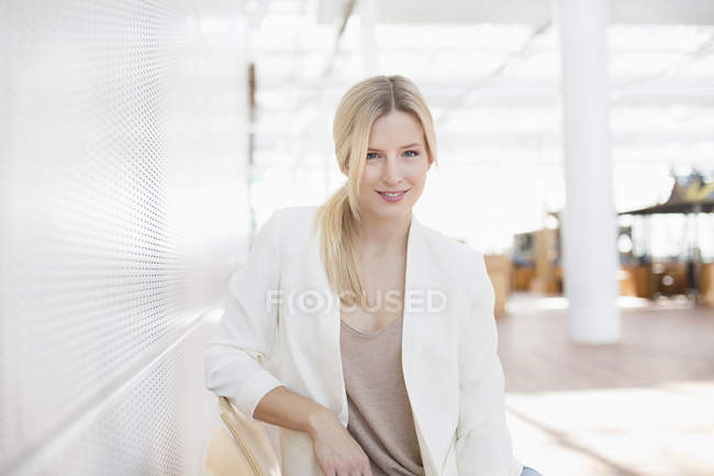 Portrait of business woman at airport — Stock Photo