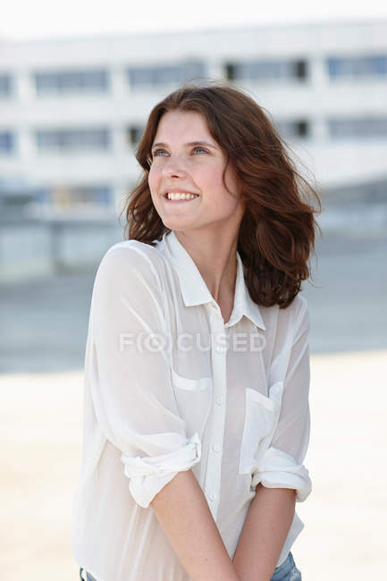 Portrait of young woman wearing white blouse looking away — Stock Photo