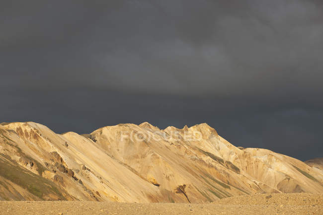 Mountain range under dramatic cloudy sky — Stock Photo
