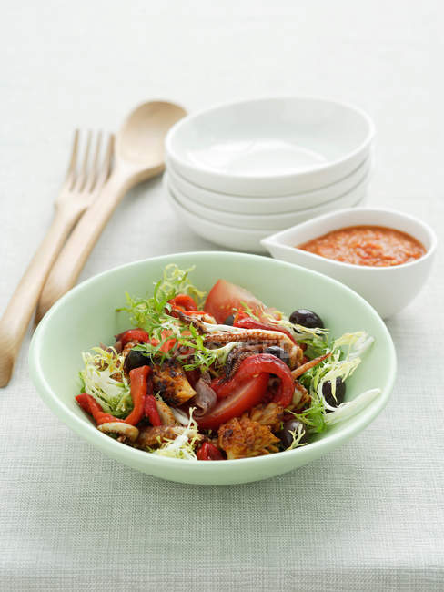 Salad with barbecued squids — Stock Photo
