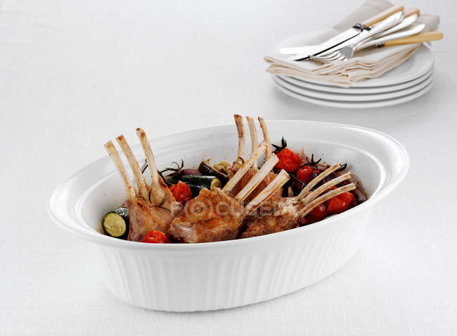 Dish of rack of lamb and vegetables — Stock Photo
