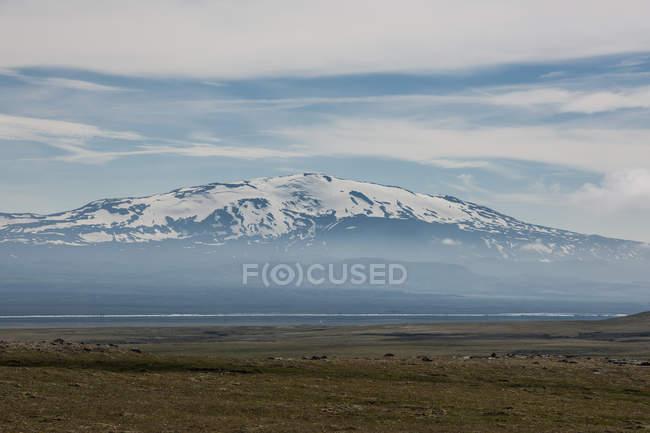 Snowcapped Volcano Hekla under blue cloudy sky — Stock Photo