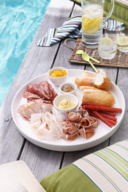 Plate of sliced meats — Stock Photo