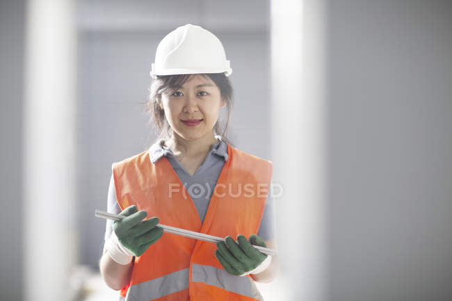 Technician holding equipment part — Stock Photo