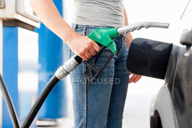 Cropped image of Young Woman at Gas Station — Stock Photo