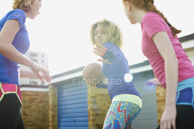 Portrait of three women exercising together playing basketball — Stock Photo