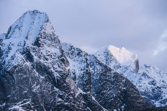 View of snowcapped mountains and storm clouds — Stock Photo