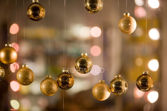 Golden Christmas baubles, close up shot — Stock Photo
