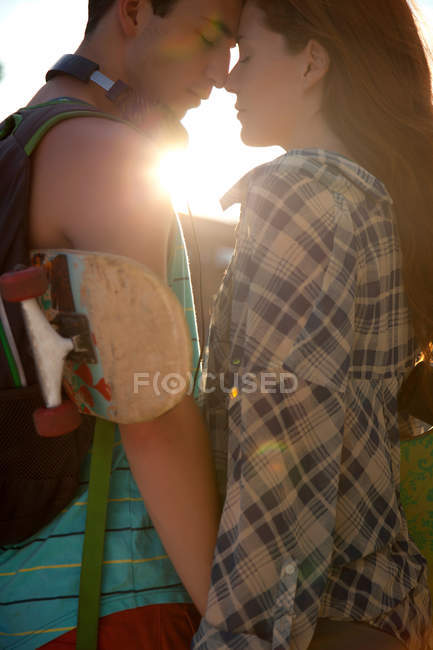Young couple face to face in sunlight — Stock Photo