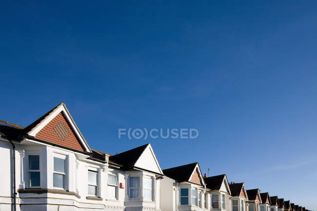 Houses tops against blue sky — Stock Photo