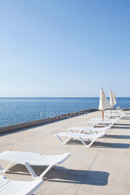 Sun loungers on deck — Stock Photo