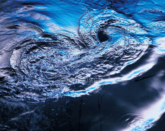 Water swirl in motion, texture background — Stock Photo