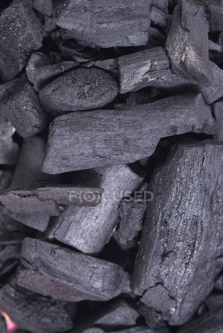 Charcoal pieces pile — Stock Photo