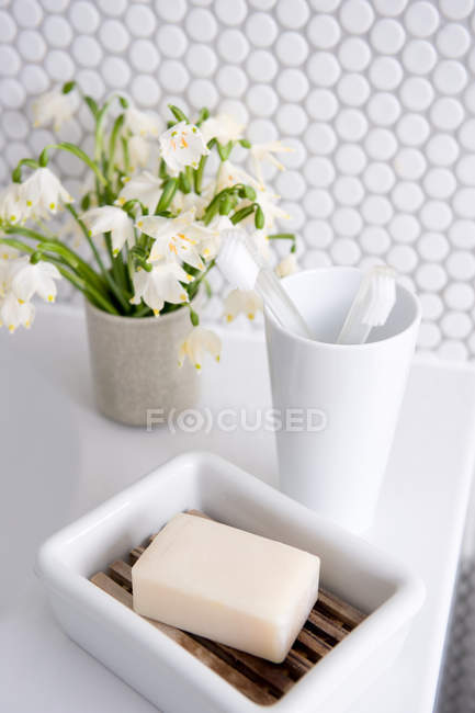 Soap with toothbrushes and bouquet — Stock Photo