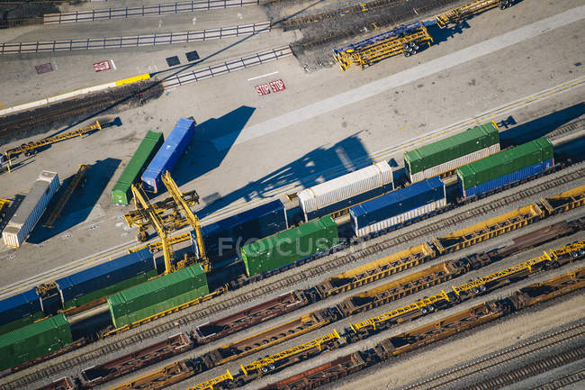 Aerial view of various shipping containers on rails in harbour — Stock Photo