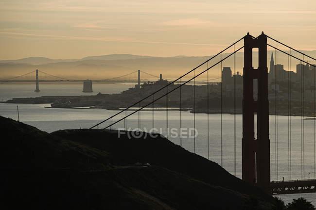 Bridges of San Francisco during sunset time, USA — Stock Photo