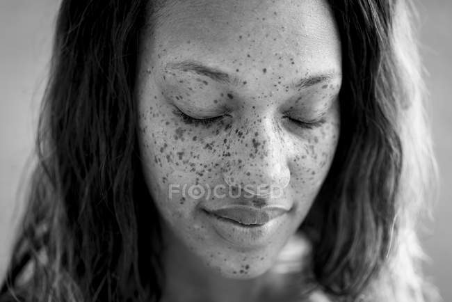 Portrait of freckled woman with eyes closed — Stock Photo