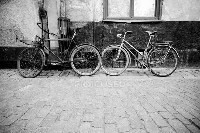 View of Two bicycles in street, black and white picture — Stock Photo