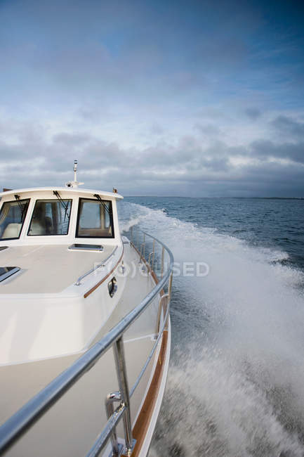 Power boat at sea with cloudy sky on background — Stock Photo
