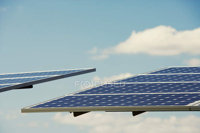 Photovoltaic panels tilted to sun — Stock Photo