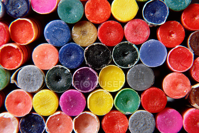 Beautiful colorful artistic background made from stacked crayons — Stock Photo