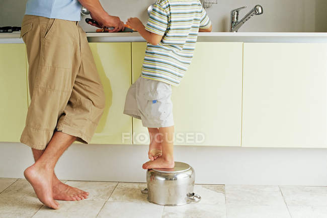Cropped image of Father and son preparing food — Stock Photo