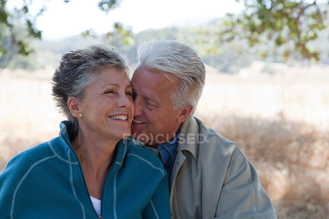 Loving mature couple outdoors in forest — Stock Photo