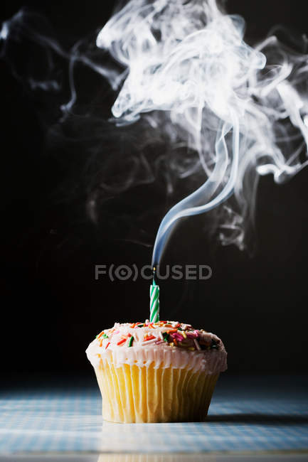 Closeup shot of birthday cake with candle on black background — Stock Photo