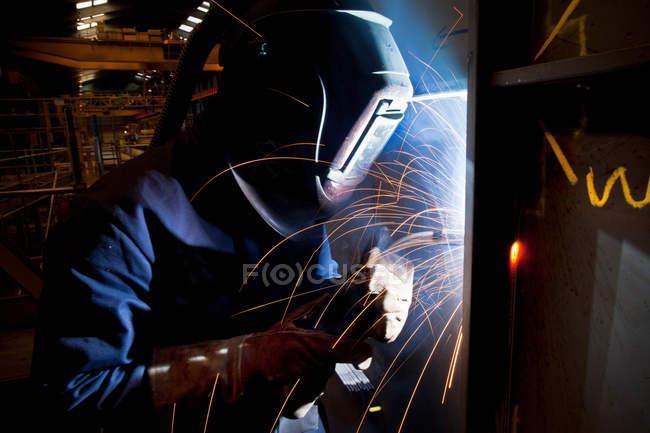 Welder at work in shipyard — Stock Photo